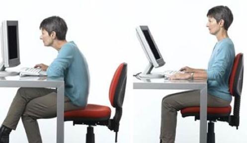 Sitting at a computer